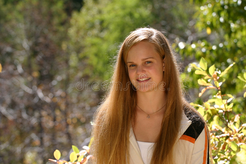 Female Teen Outdoors. Lovely smile from this smart female teenager. Taken outdoors and lots of room for copy royalty free stock image