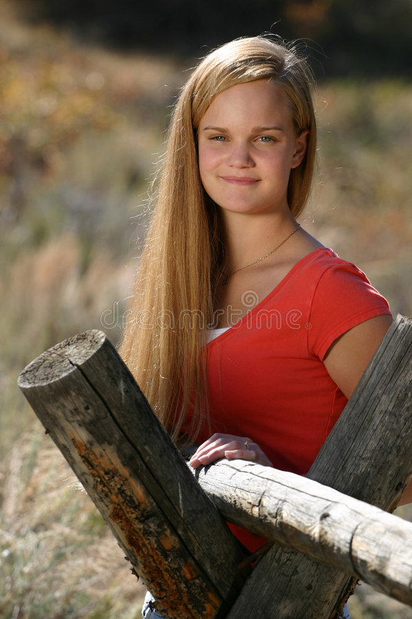 Female Teen Rural. Wonderful outdoor photo of a female teen next to an old rural wood fence royalty free stock photography