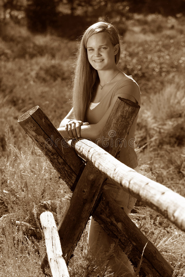 Female Teen Rural Sepia. Wonderful photo of a smiling female teen in a great rural setting. Sepia toned for effect stock images