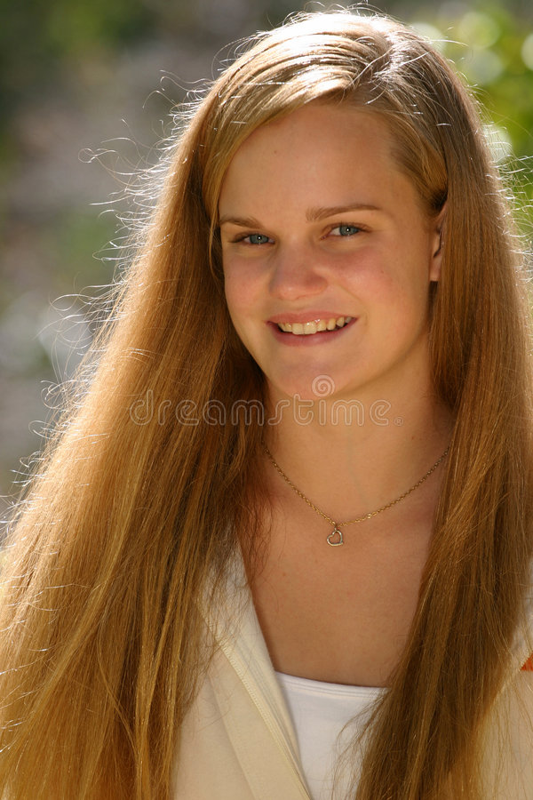 Female Teen Smile. Beautiful young female teenager with a lovely smile. Ready to deliver your positive message stock image