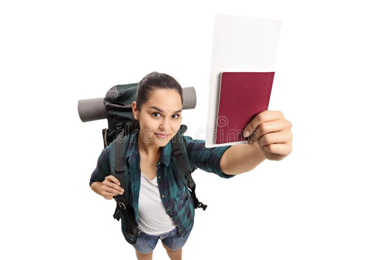 Female teenage tourist with a passport. Isolated on white background stock photos