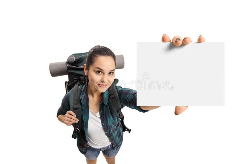 Female teenage tourist showing a blank card. Isolated on white background royalty free stock photography