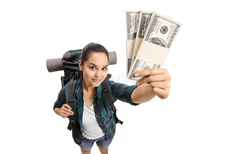 Female teenage tourist showing bundles of money. Isolated on white background royalty free stock images