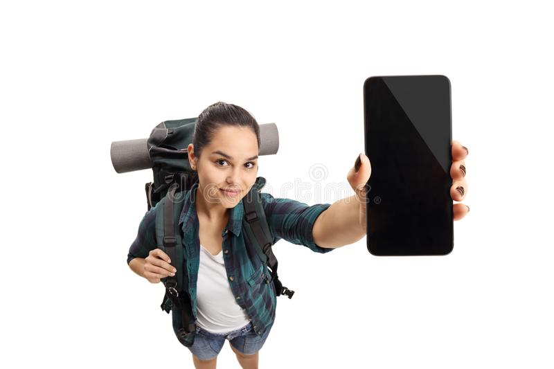 Female teenage tourist showing a phone. Isolated on white background royalty free stock image