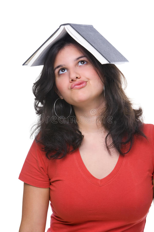 Female teenager bored and burdened by book royalty free stock image