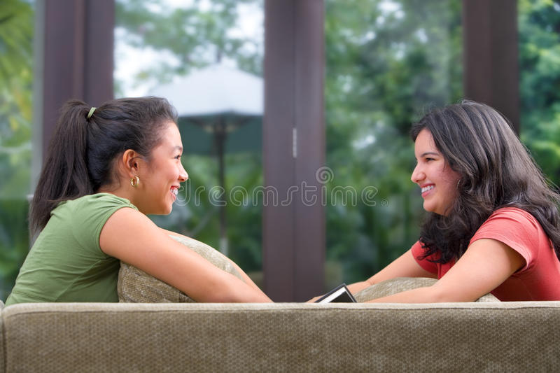 Female teenager sharing time with her friend stock photos