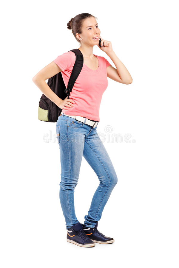 Female teenager talking on a mobile phone royalty free stock image