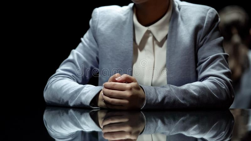 Female television presenter reporting breaking news in broadcasting studio. Stock photo royalty free stock photography