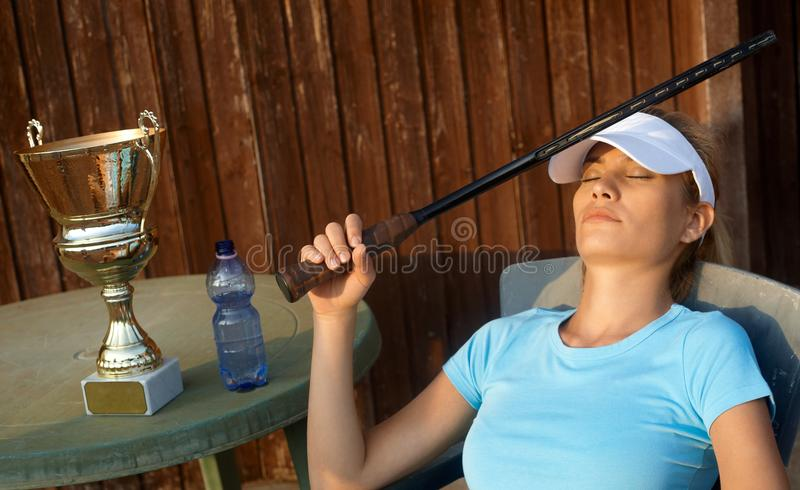 Female Tennis Champion Relaxing Stock Images