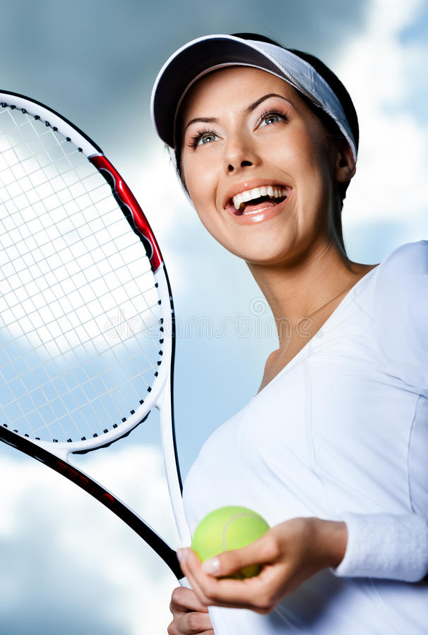 Female tennis player against the sky