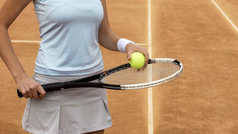 Female tennis player bouncing ball on racket, healthy lifestyle and sports hobby. Stock photo stock image