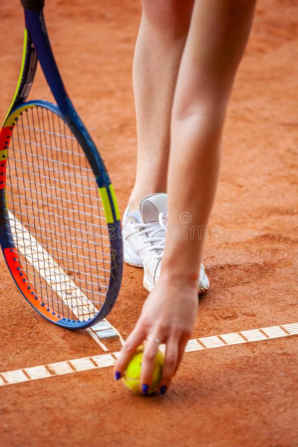 Female tennis player legs in tennis shoes standing on a clay court stock images
