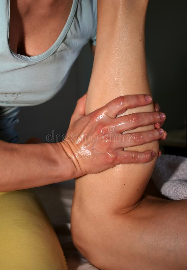Massage of the right calf royalty free stock image