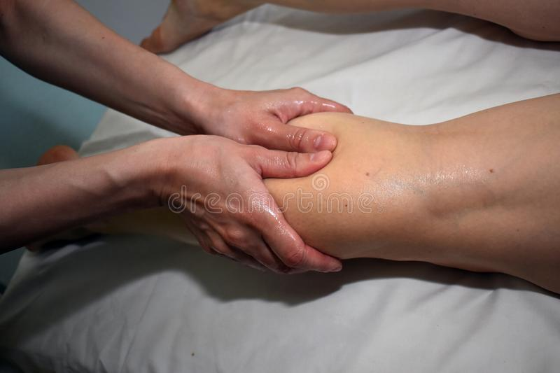 A right calf massage by therapist royalty free stock photography