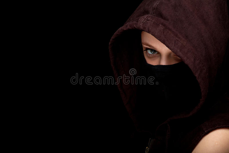 Female Thief In Mask And Hood Stock Photo