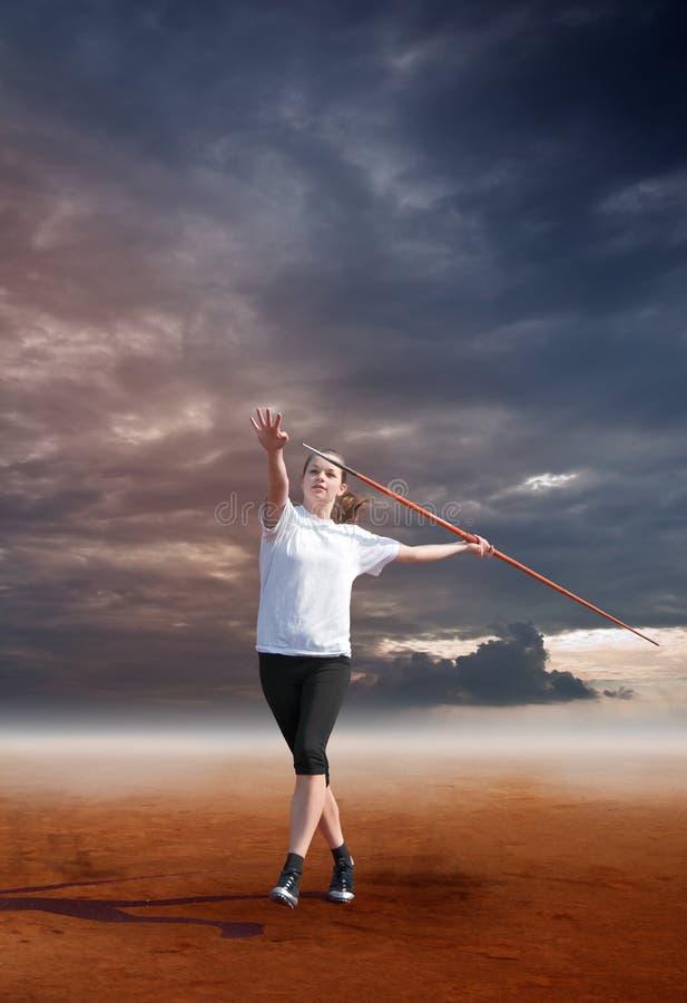 Female throwing javelin stock photos