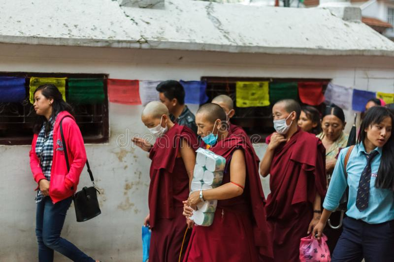 Female Tibetan monks at the Boudhanath Stupa in Kathmandu, Nepal stock images