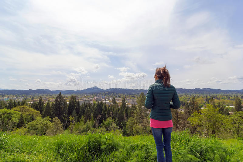 Female at top of Skinner Butte Park stock photography