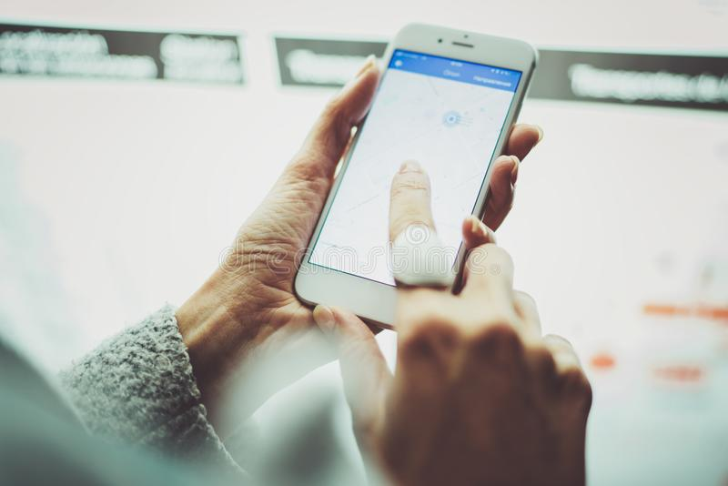 Female touching smartphone screen and using internet for looking new way on electronic city map with night modern royalty free stock photo