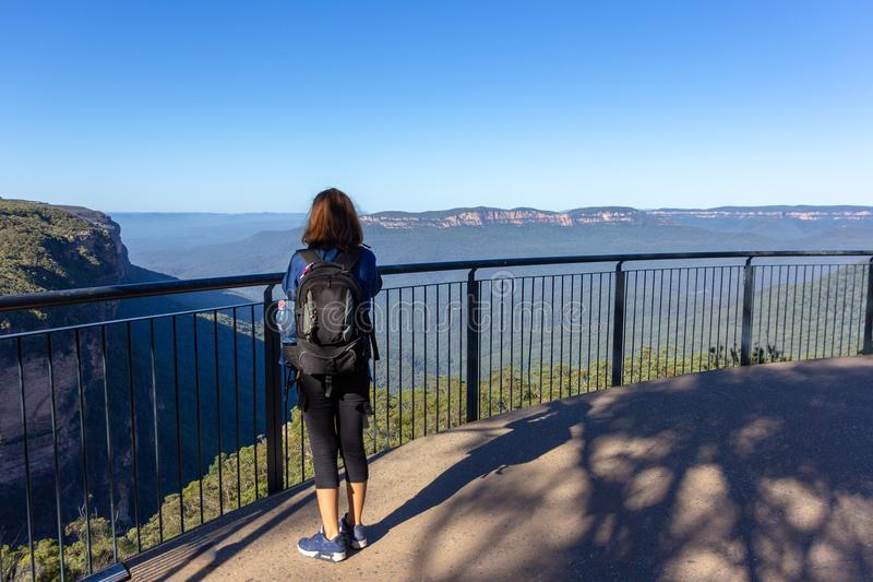 Female tourist with backpack bag Take photo at Blue Mountains, stock images