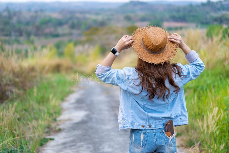 Female tourist with backpack in countryside. Female tourist with backpack in the countryside royalty free stock images