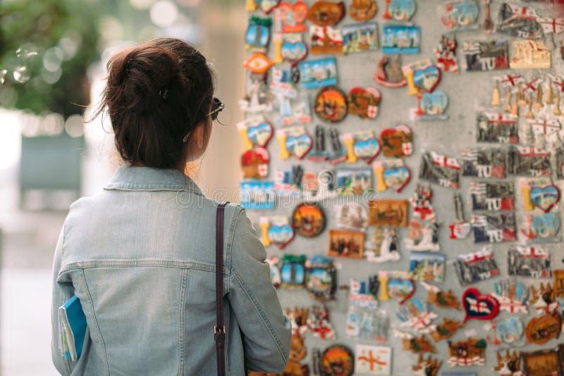 Female tourist chooses a souvenir in a shop stock photo