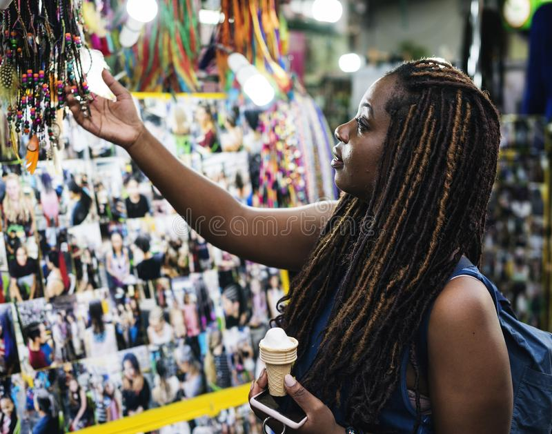 A female tourist choosing dreadlock extension royalty free stock photography
