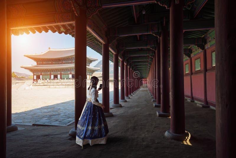 Gyeongbokgung palace. Female tourist Dressed in traditional dress Hanbok walking at Gyeongbokgung palace, Seoul South Korea stock photography
