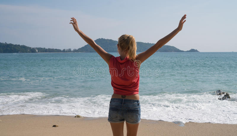 Female tourist enjoying summertime on beautiful tropical island stock photo