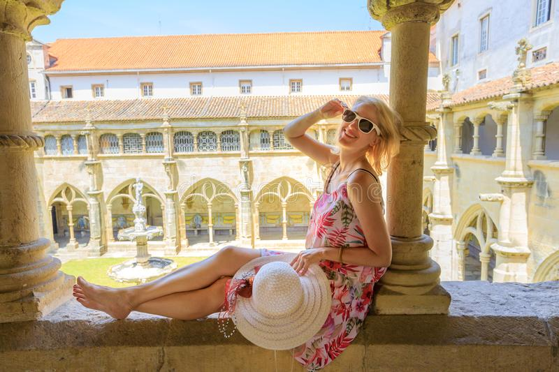 Tourist woman in Coimbra. Female tourist enjoying in university town of Coimbra in Central Portugal, Europe. Blonde caucasian woman in Santa Cruz Church with royalty free stock photos