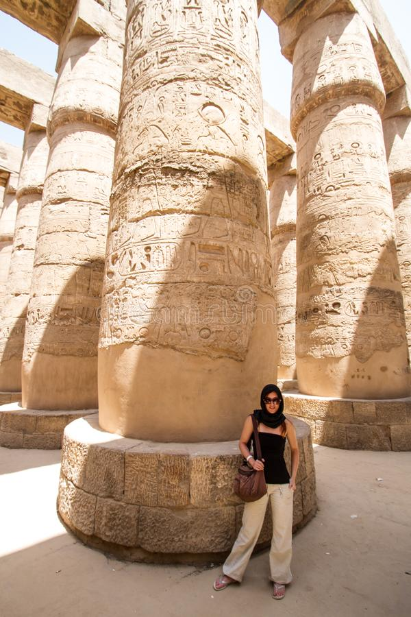 Female Tourist at Temples of Karnak, ancient Thebes in Luxor, Egypt. Female Tourist at Great Hypostyle Hall at the Temples of Karnak, ancient Thebes in Luxor royalty free stock images
