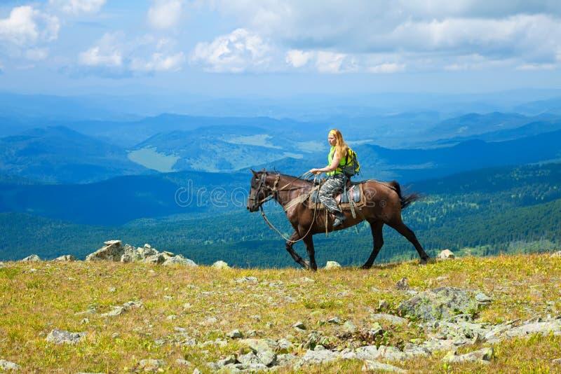 Female tourist on horseback stock image