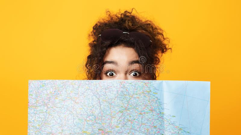 Female Tourist Looking Out From Map, Closeup stock photography