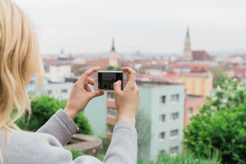 Female tourist photographing view Cluj Napoca. Traveling Romania stock photos