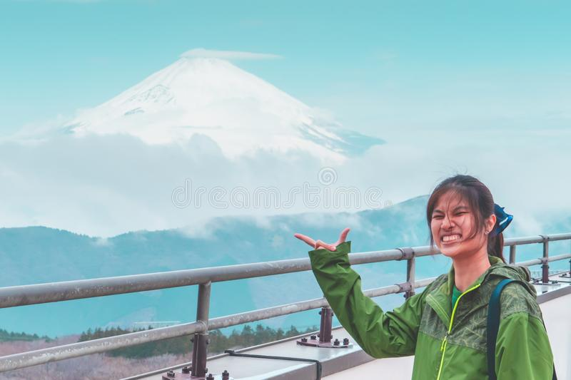 Female is posting hand with Mount Fuji on the background royalty free stock image