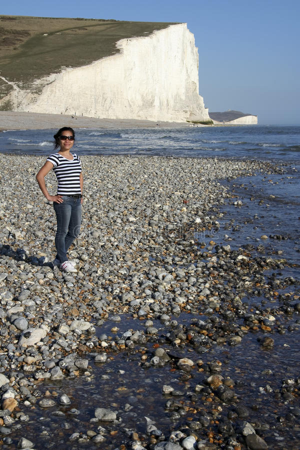 Female tourist seven sisters beach england stock images