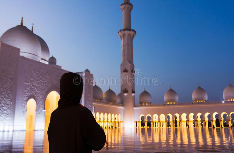 Female tourist at Sheikh Zayed Grand Mosque stock image