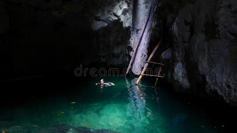 Female tourist swimming in a natural pool in Raja Ampat. Trekking in the Mayalibit area in Raja Ampat. Natural pool with fresh water royalty free stock photo