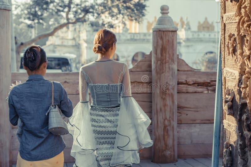 Female tourist take a photo at Shwe Nan Daw Kyaung Golden Palace Monastery in Mandalay. Myanmar stock photo