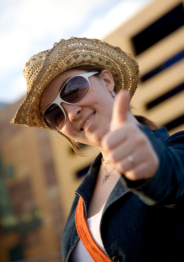 Female tourist with thumbs up