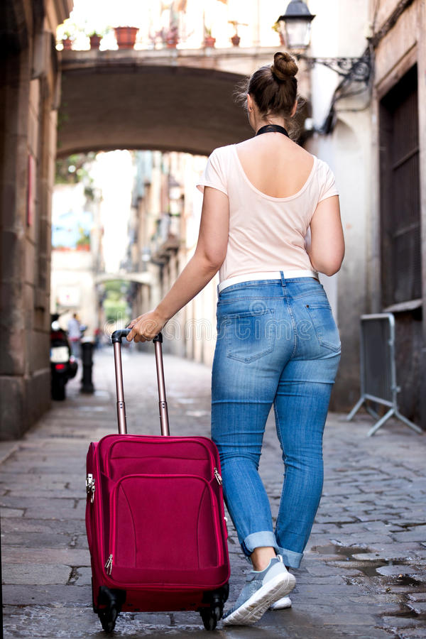 Female tourist is walking. Around the city royalty free stock photography
