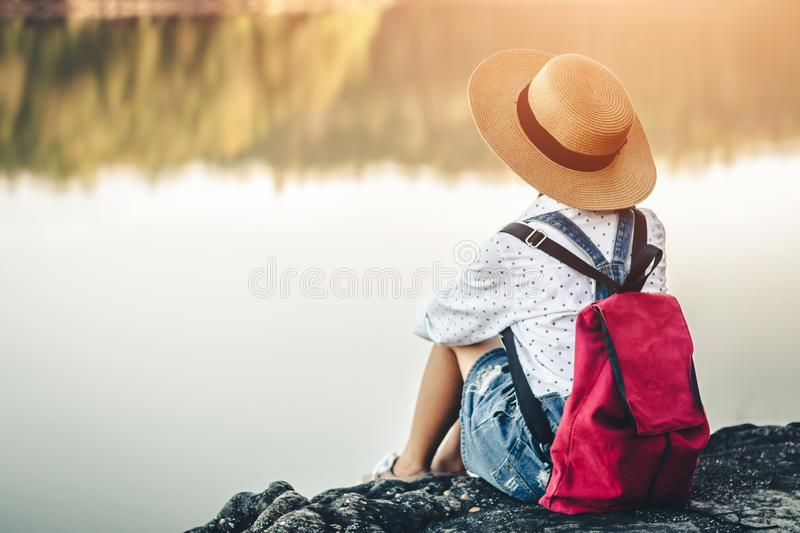 Female tourists in beautiful nature in tranquil scene of rivers and mountains royalty free stock image