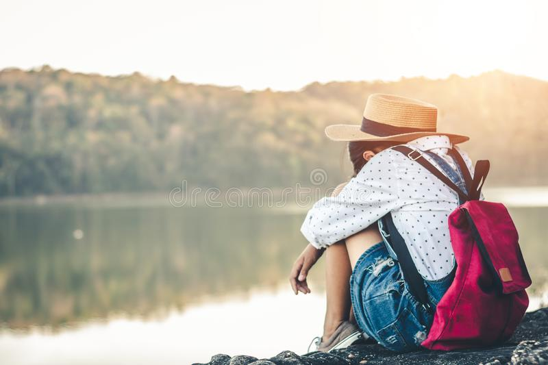 Female tourists in beautiful nature in tranquil scene of rivers and mountains stock photos