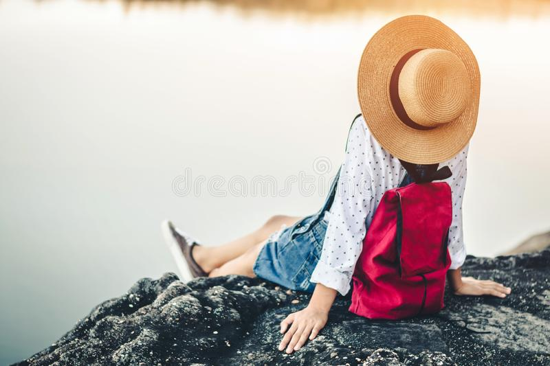 Female tourists in beautiful nature in tranquil scene of rivers and mountains royalty free stock images