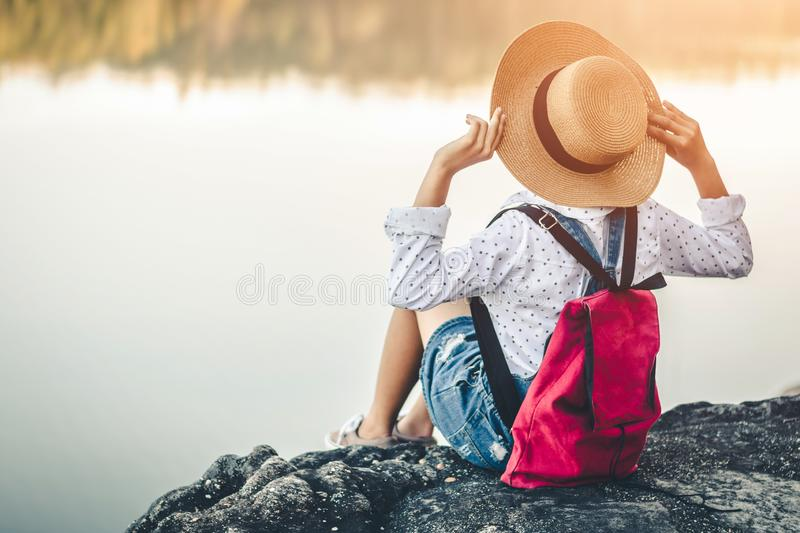 Female tourists in beautiful nature in tranquil scene of rivers and mountains royalty free stock photography