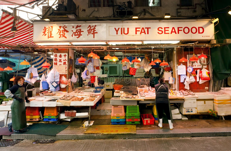 Female traders of fish market spread seafood for sale on a street tray royalty free stock image