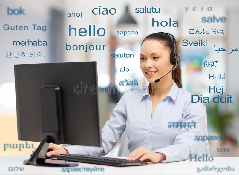 Female translator over words in foreign languages stock image