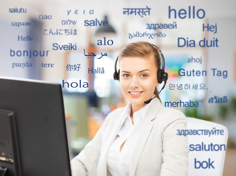 Female translator over words in foreign languages royalty free stock images