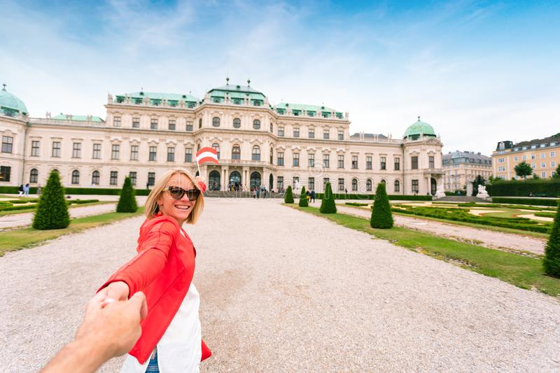 Female traveler on the background of Belvedere Palace complex of the 18th century in Vienna, Austria. stock images