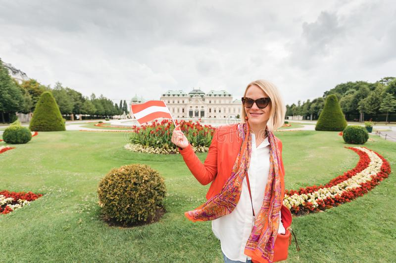 Female traveler on the background of Belvedere Palace complex of the 18th century in Vienna, Austria. royalty free stock image